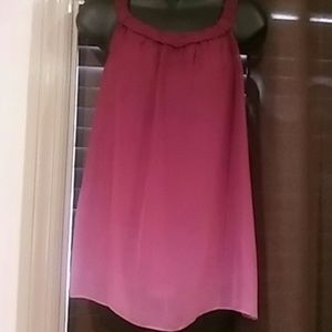 Trulli med sleeveless top. Burgendy colored